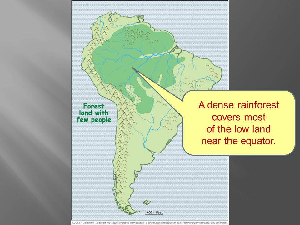 A dense rainforest covers most of the low land near the equator.