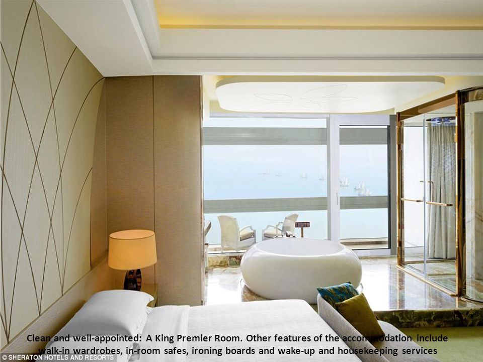 Two double beds in one of the Sheraton Huzhou's Twin Premier Rooms. Each room includes a private balcony, a large work desk with an ergonomic chair, H