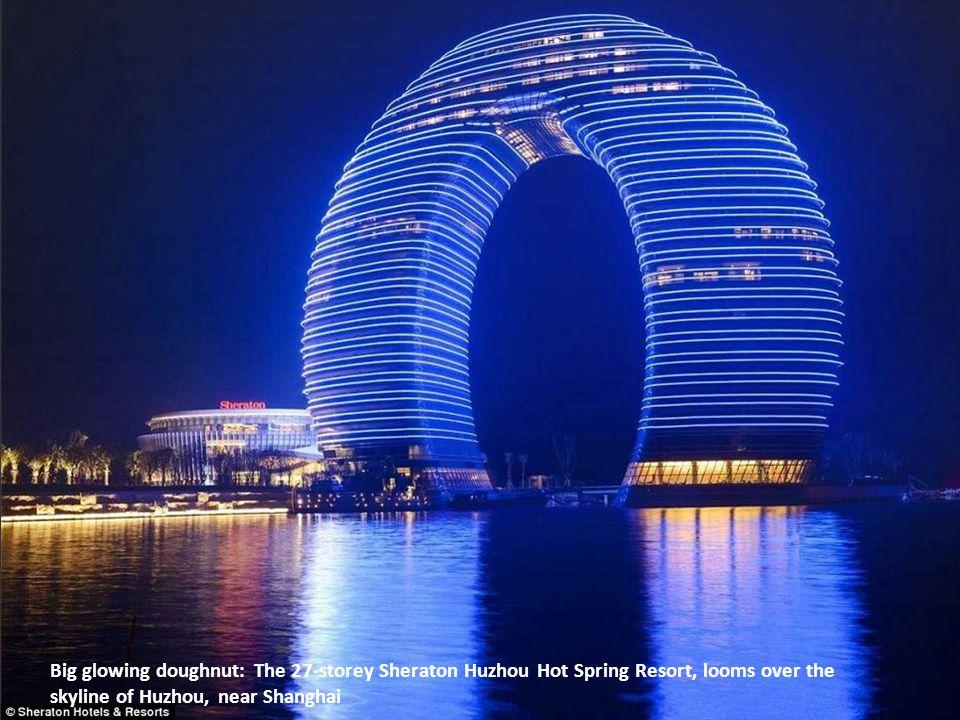 Big glowing doughnut: The 27-storey Sheraton Huzhou Hot Spring Resort, looms over the skyline of Huzhou, near Shanghai