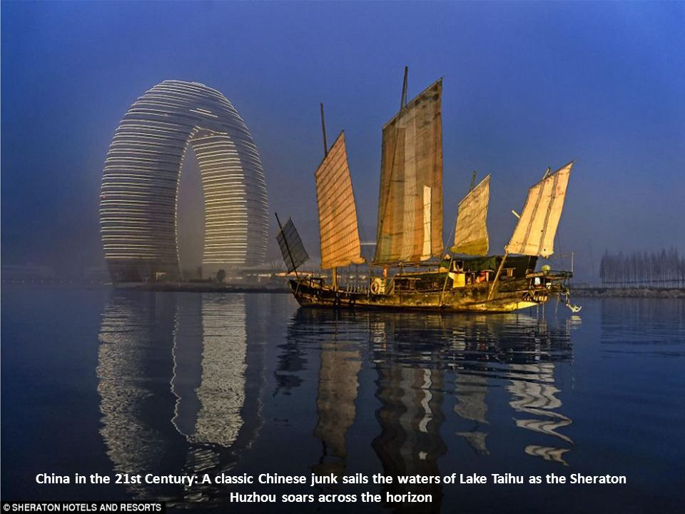 China in the 21st Century: A classic Chinese junk sails the waters of Lake Taihu as the Sheraton Huzhou soars across the horizon