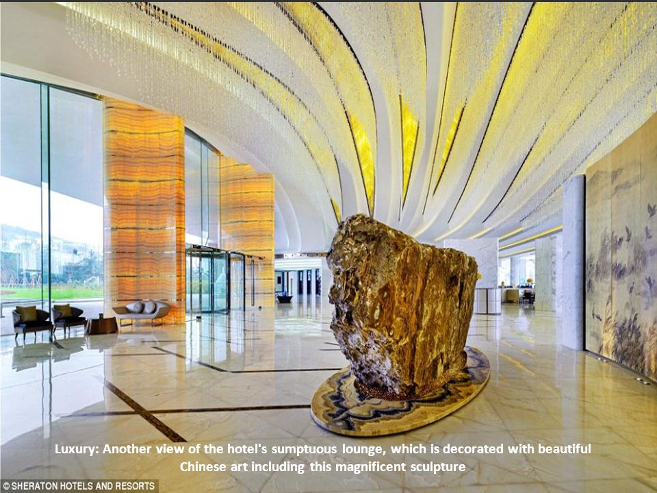 Luxury: Another view of the hotel s sumptuous lounge, which is decorated with beautiful Chinese art including this magnificent sculpture