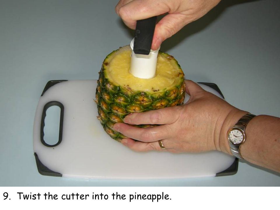9. Twist the cutter into the pineapple.