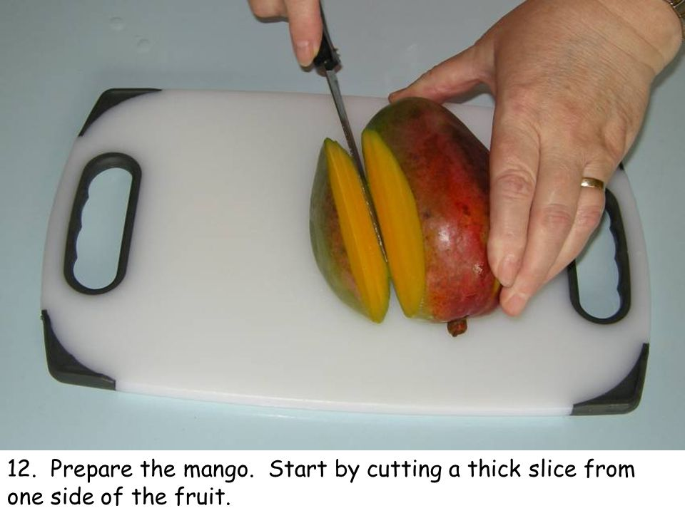12. Prepare the mango. Start by cutting a thick slice from one side of the fruit.