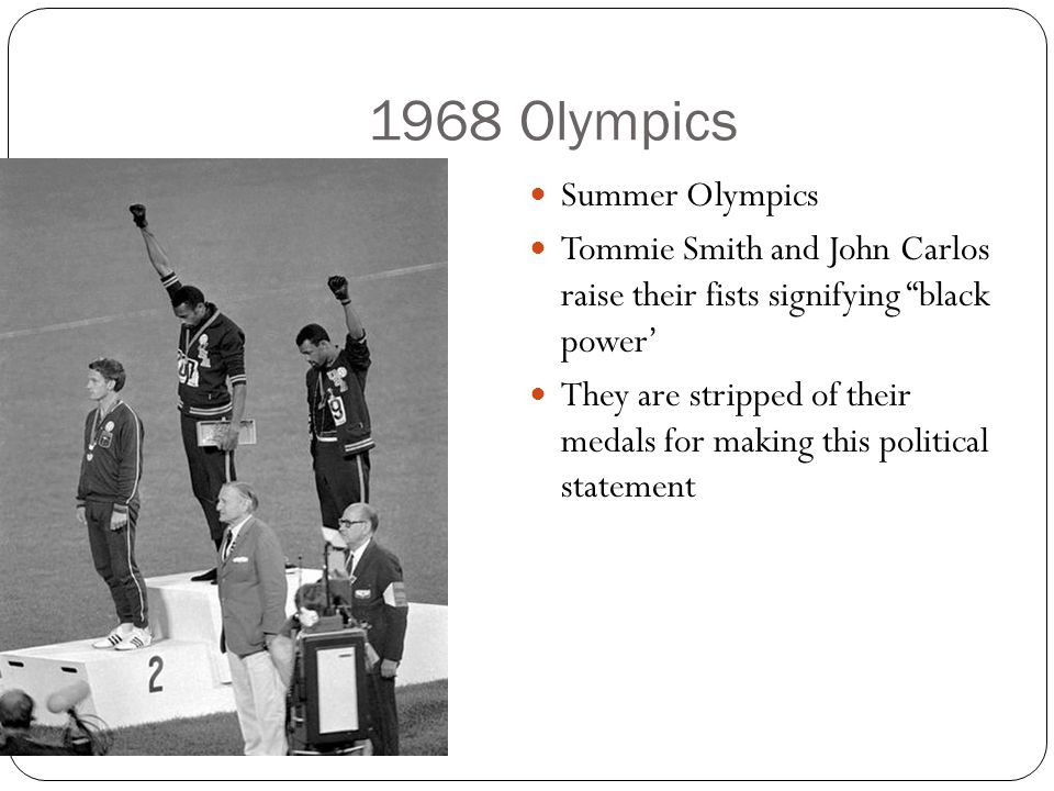 1968 Olympics Summer Olympics Tommie Smith and John Carlos raise their fists signifying black power' They are stripped of their medals for making this political statement