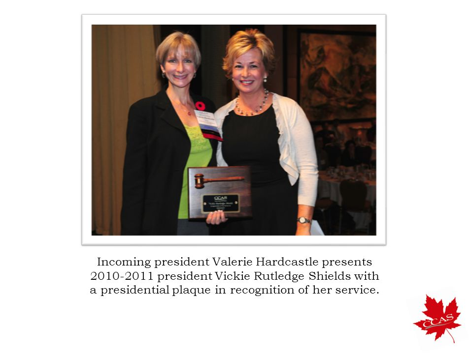 Incoming president Valerie Hardcastle presents 2010-2011 president Vickie Rutledge Shields with a presidential plaque in recognition of her service.