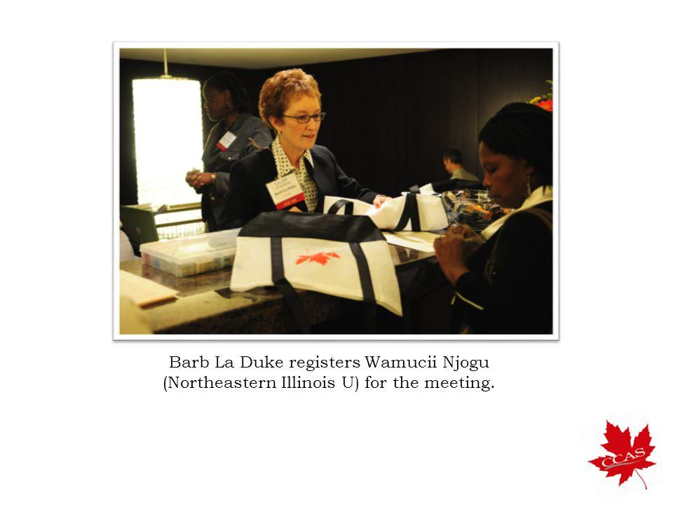Barb La Duke registers Wamucii Njogu (Northeastern Illinois U) for the meeting.