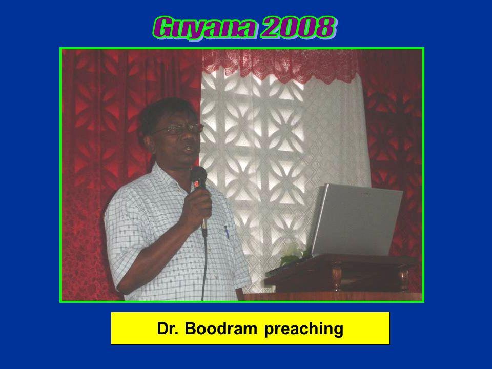 Dr. Boodram preaching
