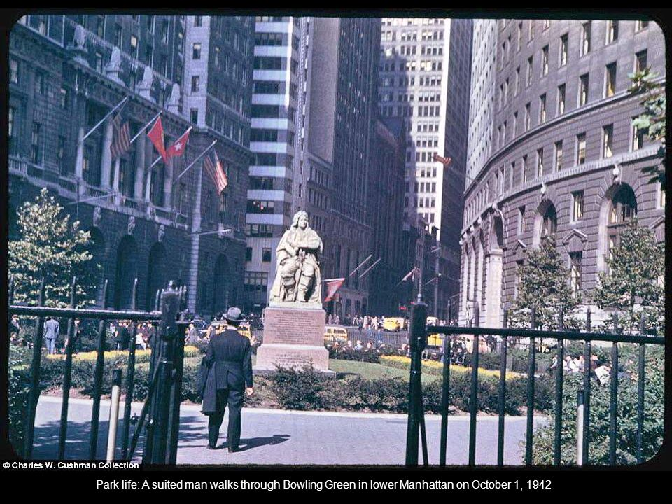 Park life: A suited man walks through Bowling Green in lower Manhattan on October 1, 1942 :