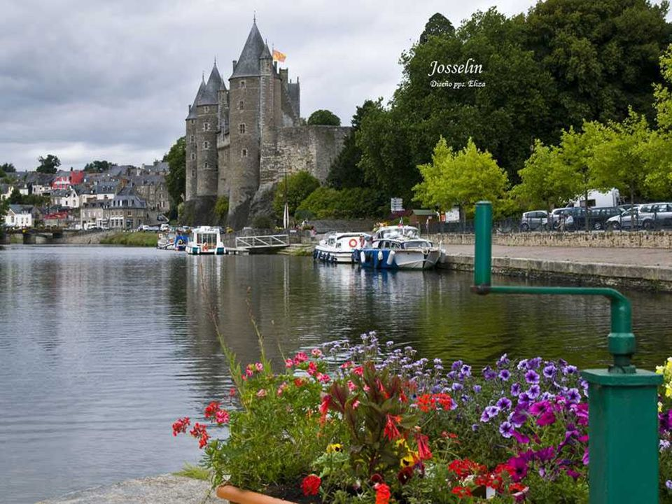 Josselin The impressive castle towers are reflected in the waters of Oust.