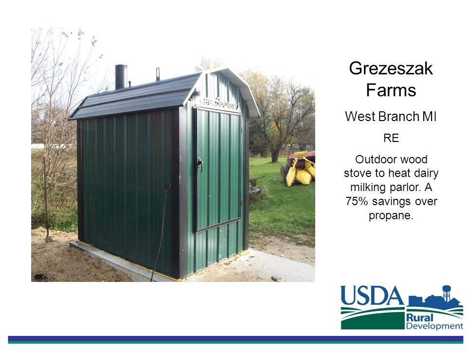 Grezeszak Farms West Branch MI RE Outdoor wood stove to heat dairy milking parlor.