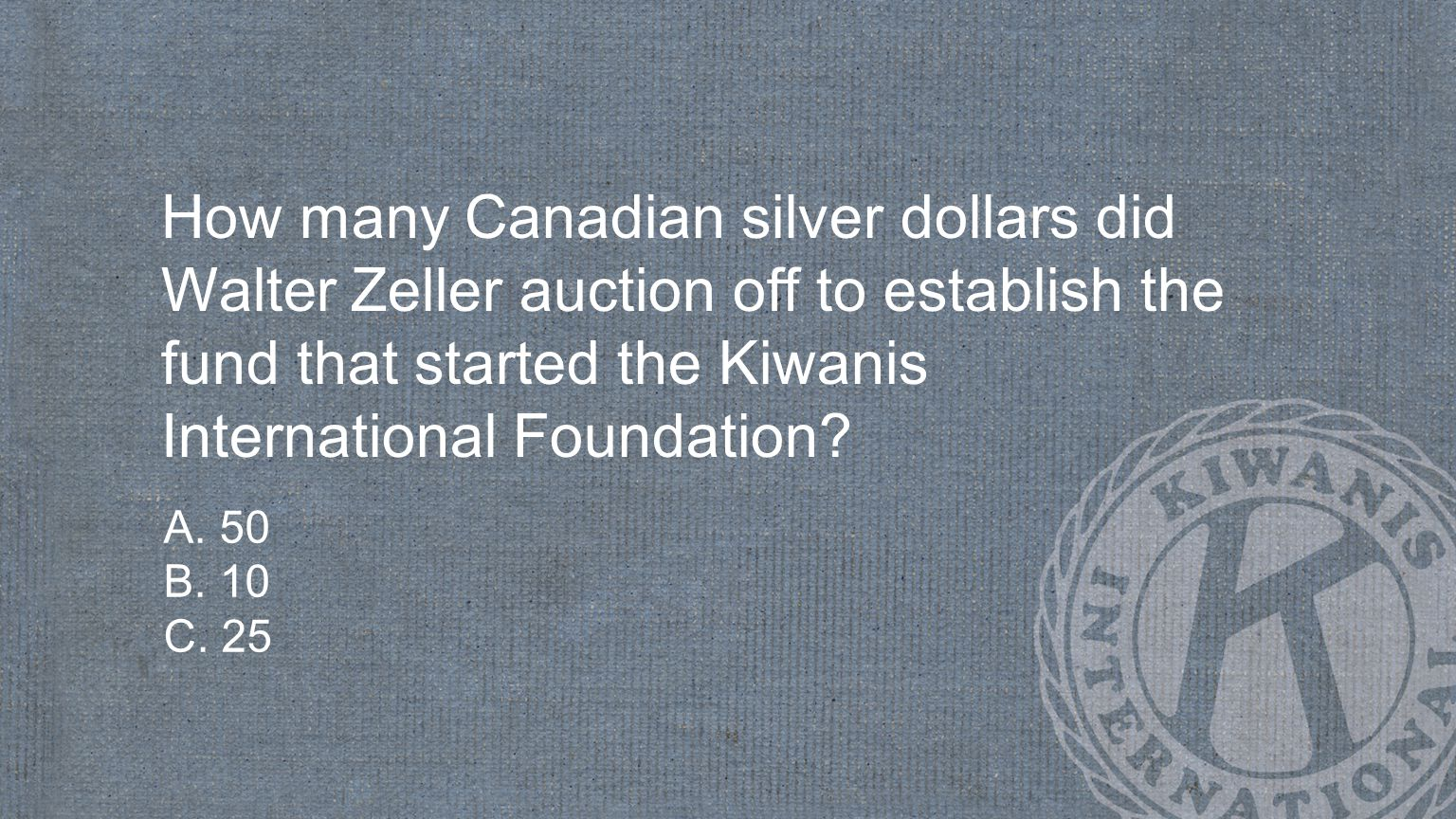 How many Canadian silver dollars did Walter Zeller auction off to establish the fund that started the Kiwanis International Foundation.