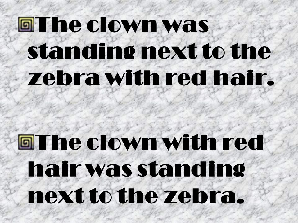 The clown was standing next to the zebra with red hair.