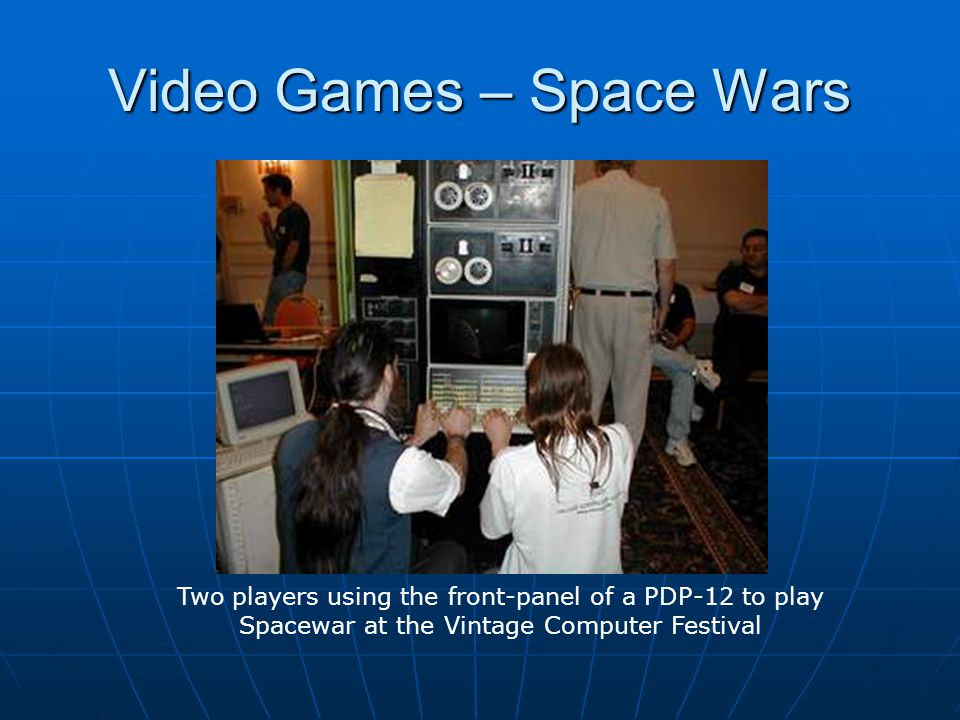 Video Games – Space Wars Two players using the front-panel of a PDP-12 to play Spacewar at the Vintage Computer Festival