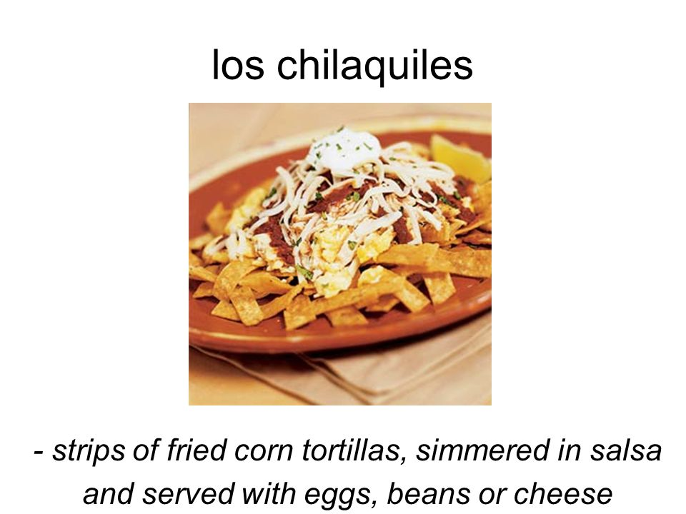 los chilaquiles - strips of fried corn tortillas, simmered in salsa and served with eggs, beans or cheese