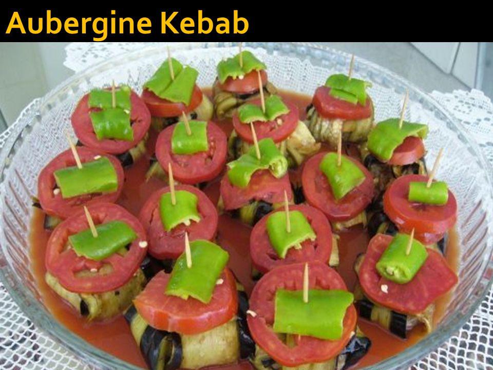  Eggplant Kebab (Patlican Kebabi)  Ingredients: - 5 eggplants - 1/2 pound ground lamb or beef - 1/2 tablespoon tomato paste - 1/2 teaspoon red pepper flakes - 1/2 teaspoon ground black pepper - 1/2 teaspoon salt - Olive oil for brushing Optional: cayenne pepper, chilli pepper, paprika to taste   The Recipe:  Peel the eggplants striped.
