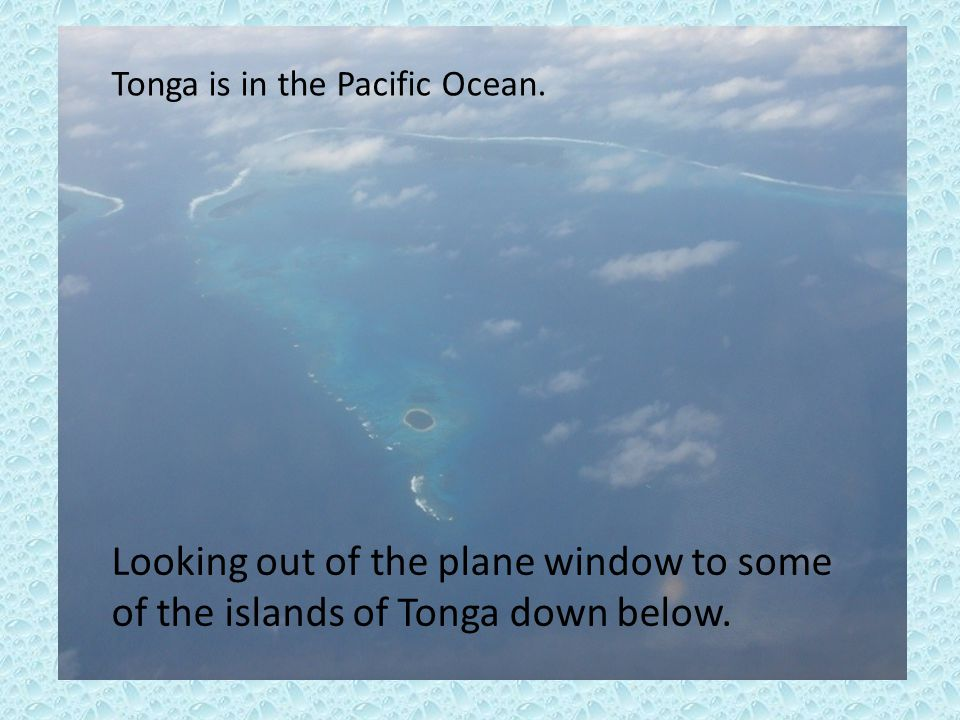 Looking out of the plane window to some of the islands of Tonga down below. Tonga is in the Pacific Ocean.