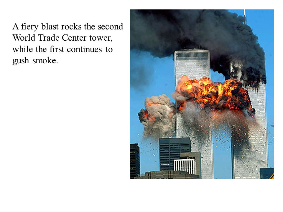 A fiery blast rocks the second World Trade Center tower, while the first continues to gush smoke.