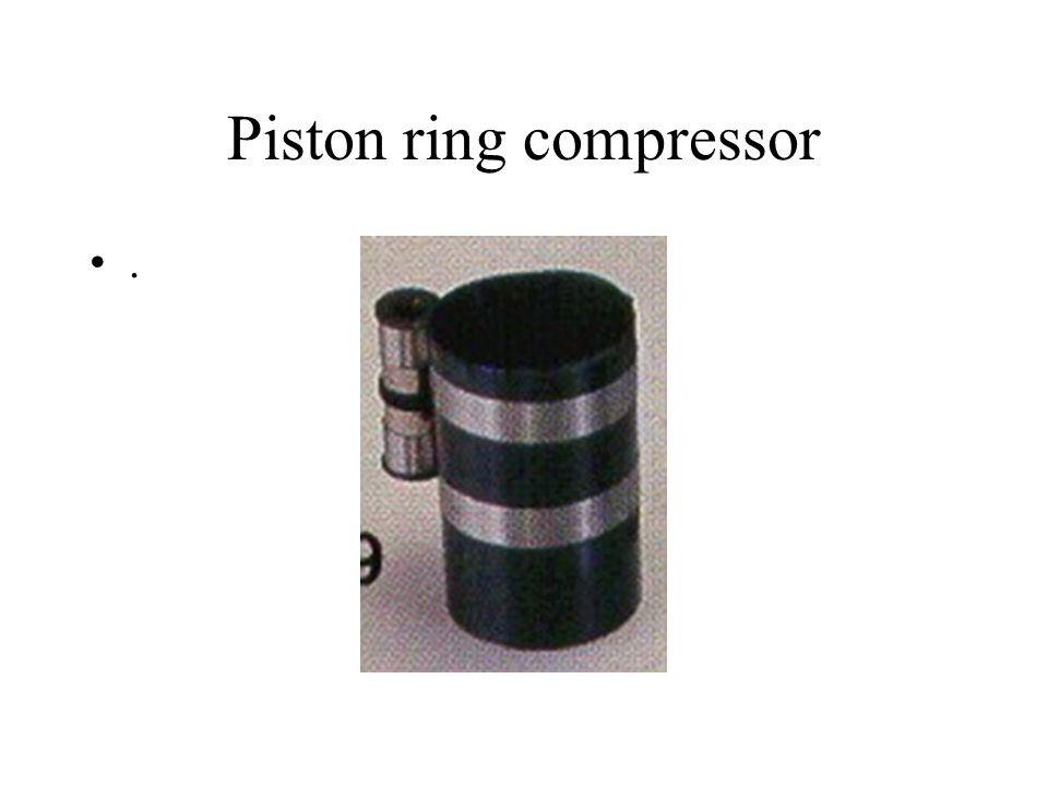 Piston ring compressor.