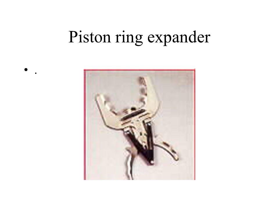 Piston ring expander.