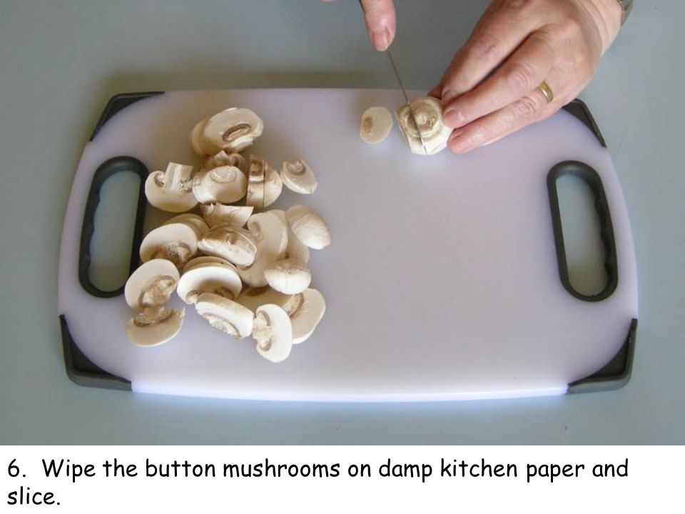6. Wipe the button mushrooms on damp kitchen paper and slice.
