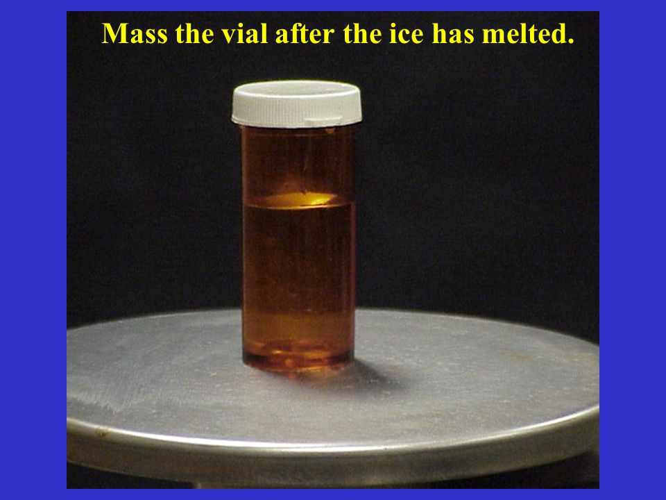 Mass the vial after the ice has melted.