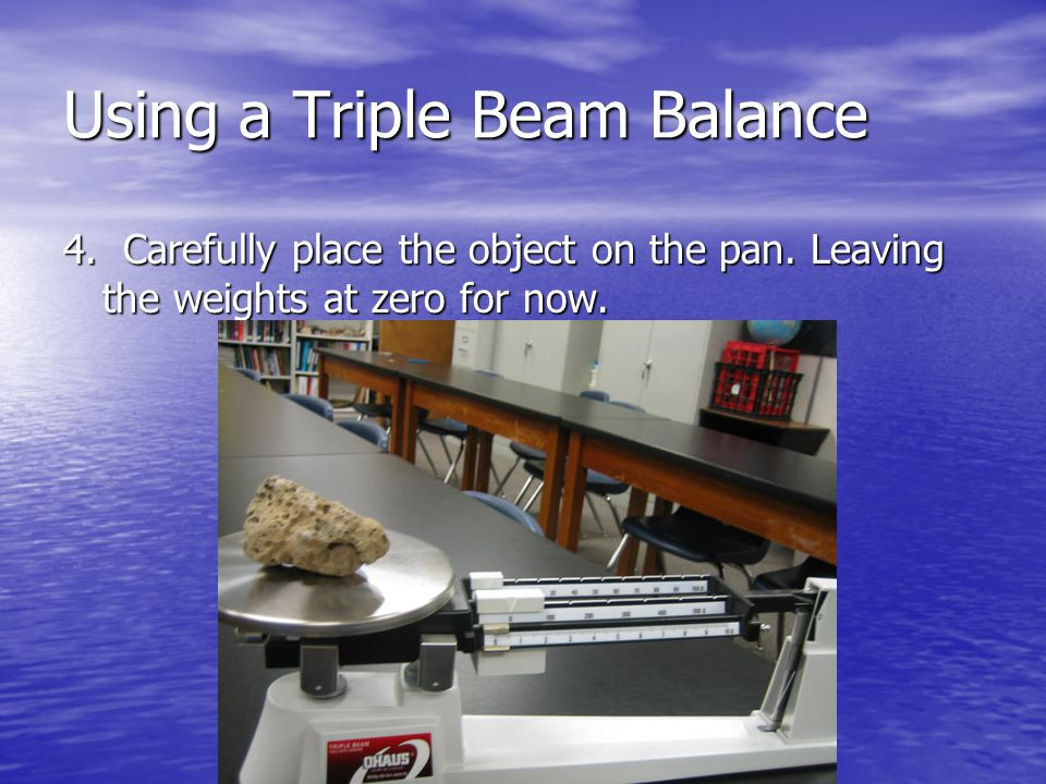 4. Carefully place the object on the pan. Leaving the weights at zero for now.