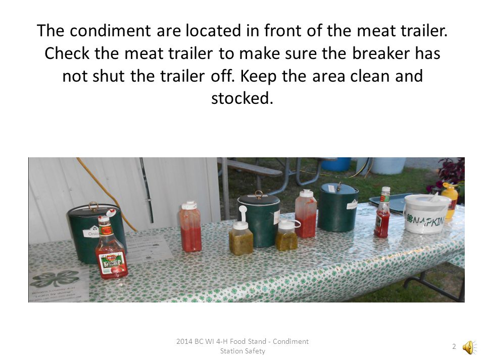 The condiment are located in front of the meat trailer.