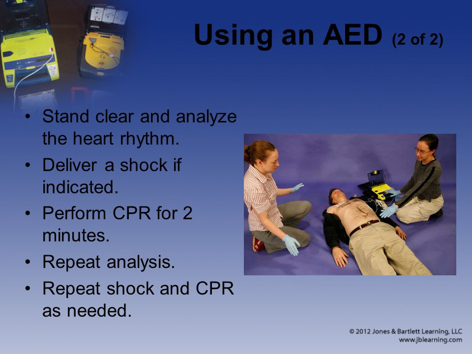 Using an AED (2 of 2) Stand clear and analyze the heart rhythm.