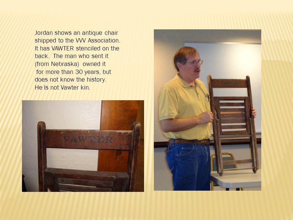Jordan shows an antique chair shipped to the VVV Association.