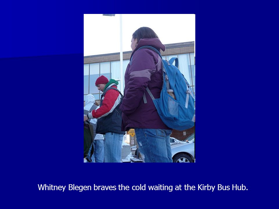 Whitney Blegen braves the cold waiting at the Kirby Bus Hub.