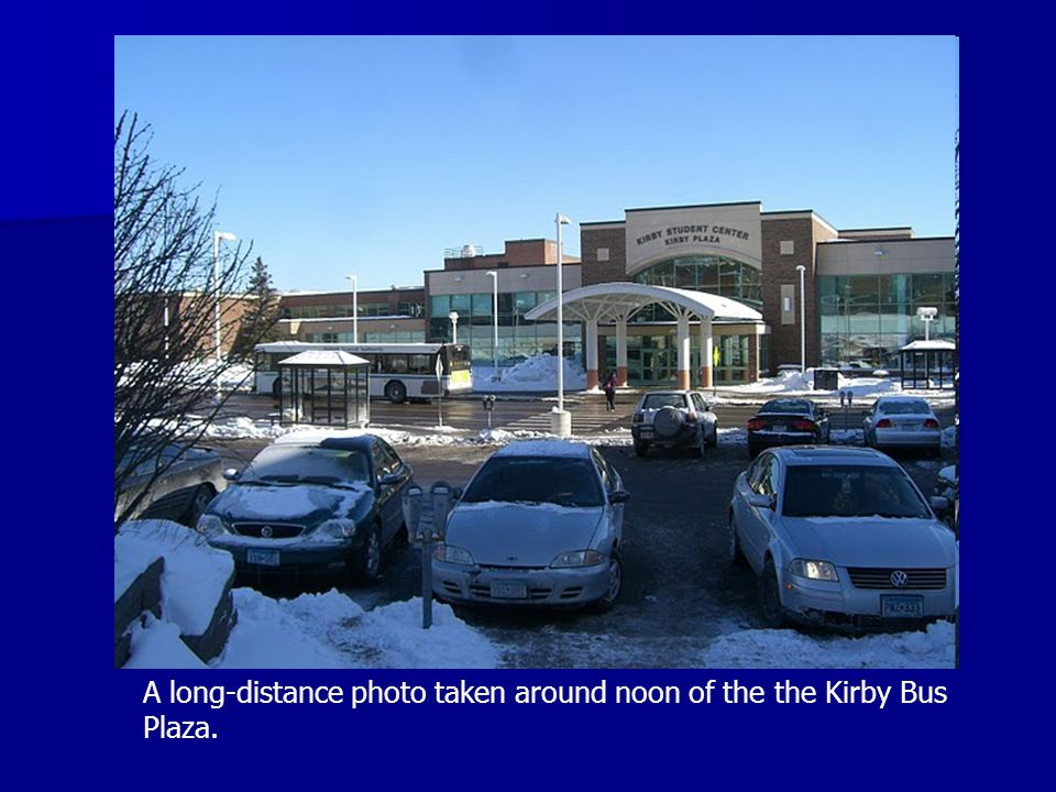 A long-distance photo taken around noon of the the Kirby Bus Plaza.