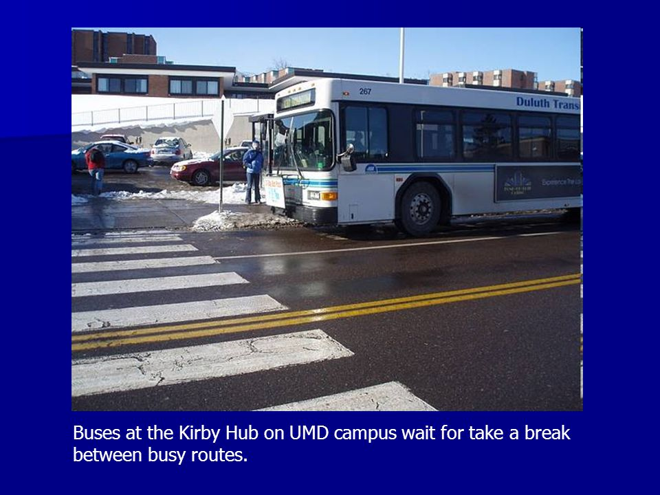 Buses at the Kirby Hub on UMD campus wait for take a break between busy routes.