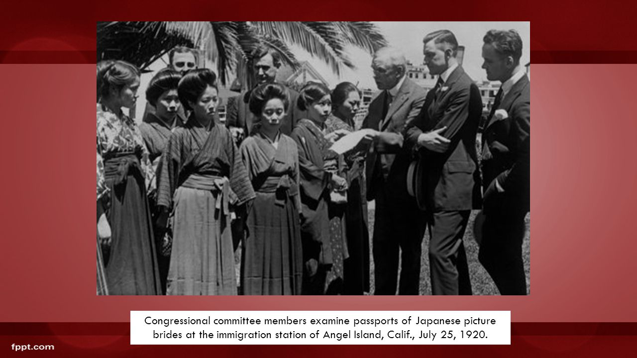 Congressional committee members examine passports of Japanese picture brides at the immigration station of Angel Island, Calif., July 25, 1920.