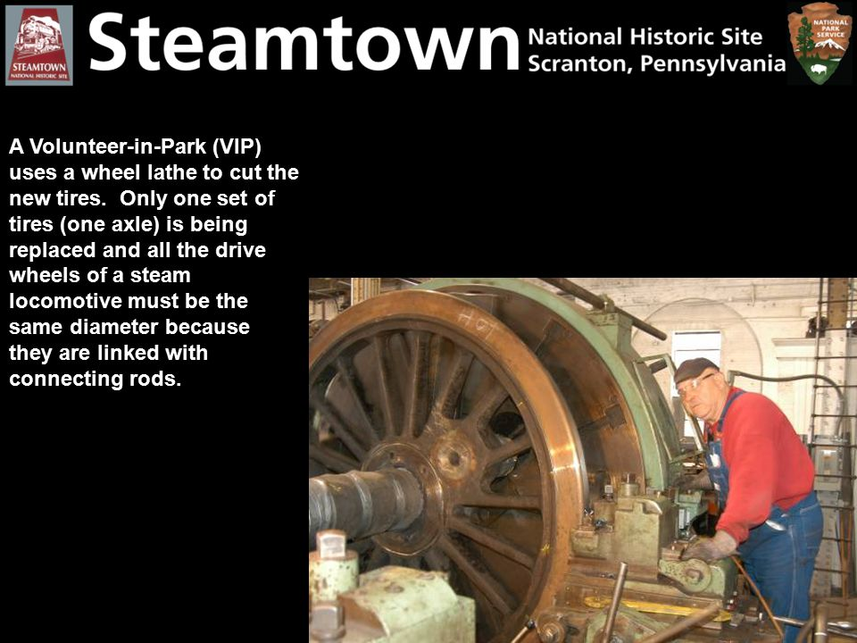 A Volunteer-in-Park (VIP) uses a wheel lathe to cut the new tires. Only one set of tires (one axle) is being replaced and all the drive wheels of a st