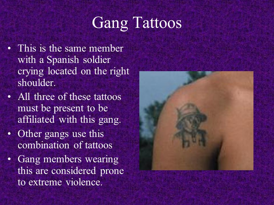 Gang Tattoos This is the same member with a Spanish soldier crying located on the right shoulder.