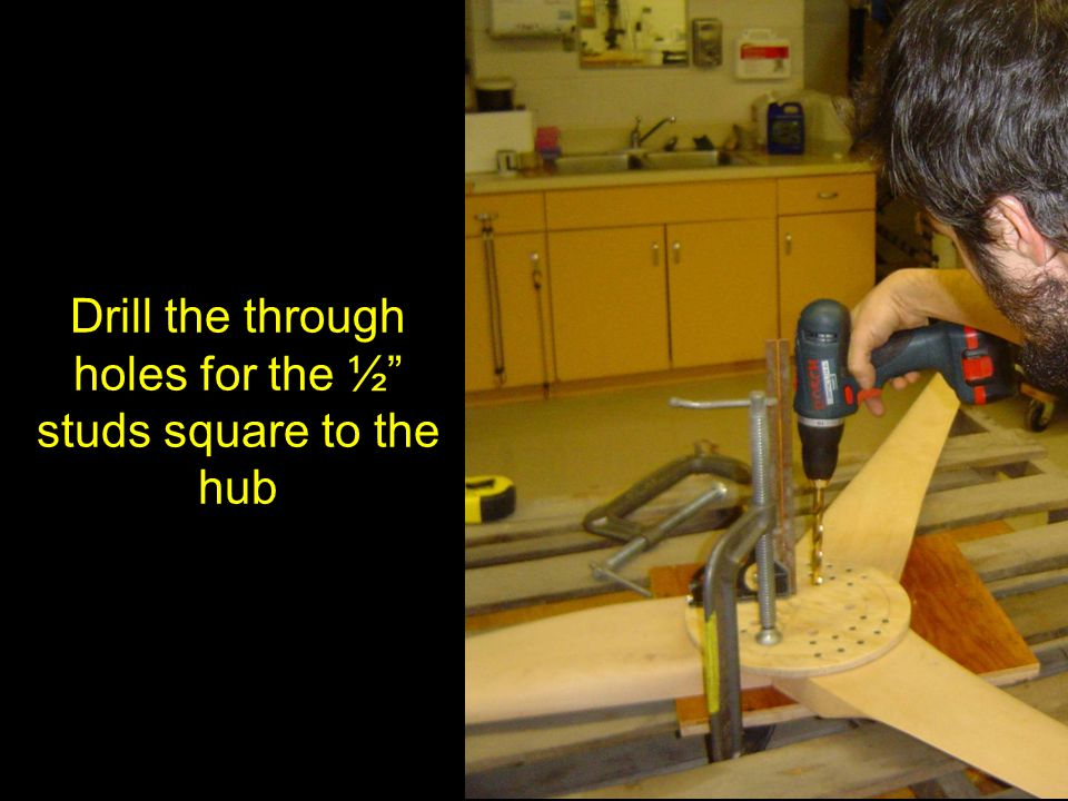 Drill the through holes for the ½ studs square to the hub