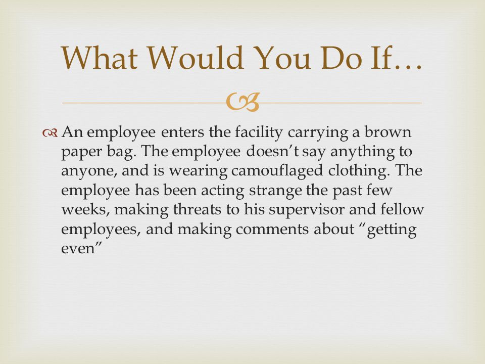   An employee enters the facility carrying a brown paper bag.