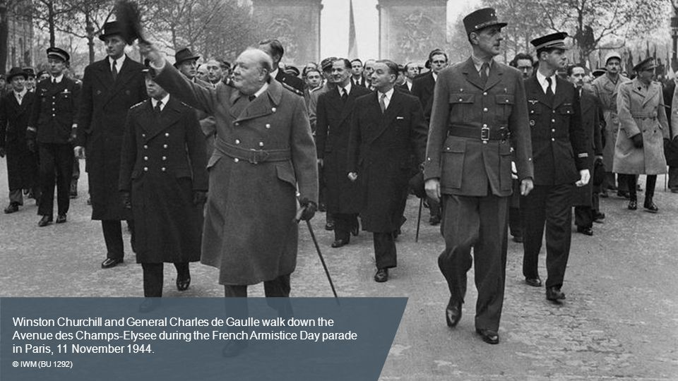 Winston Churchill and General Charles de Gaulle walk down the Avenue des Champs-Elysee during the French Armistice Day parade in Paris, 11 November 1944.