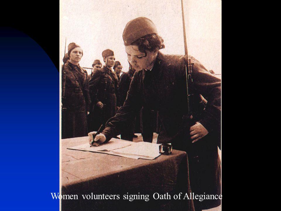 Women volunteers signing Oath of Allegiance