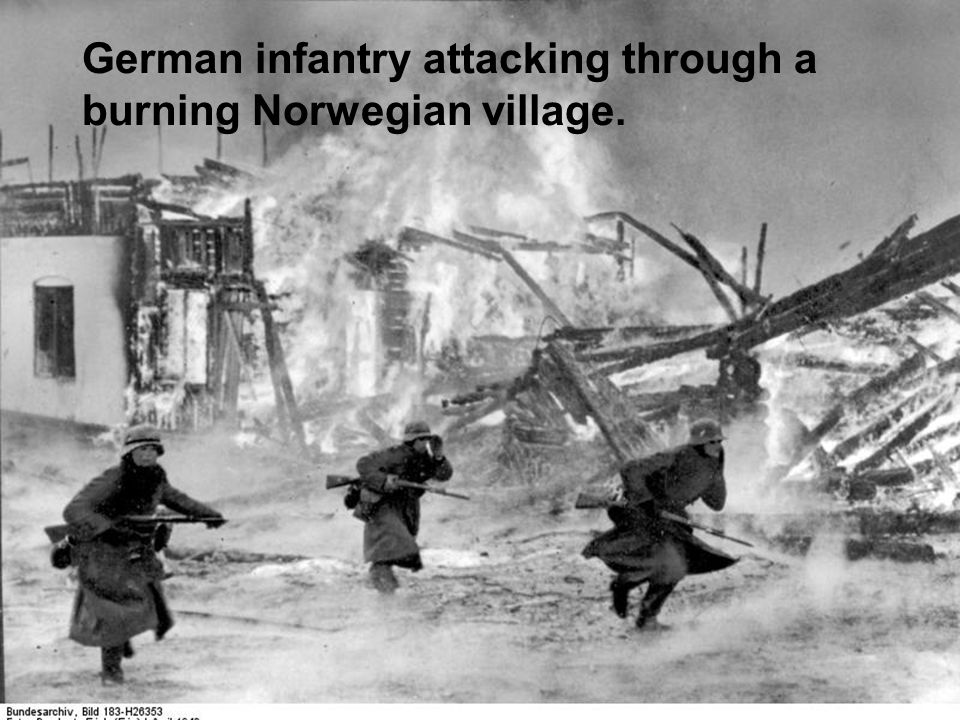 German infantry attacking through a burning Norwegian village.