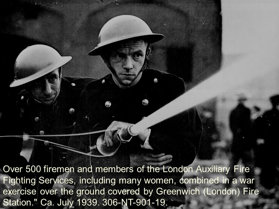 Over 500 firemen and members of the London Auxiliary Fire Fighting Services, including many women, combined in a war exercise over the ground covered by Greenwich (London) Fire Station. Ca.