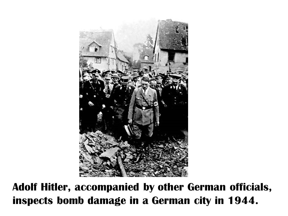 Adolf Hitler, accompanied by other German officials, inspects bomb damage in a German city in 1944.