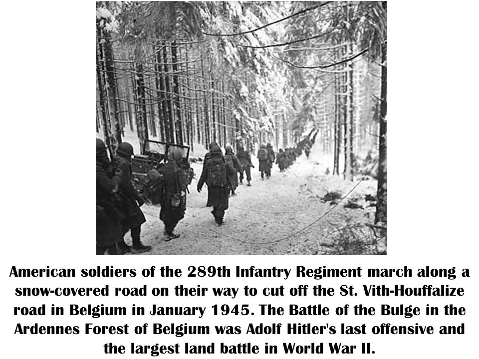 American soldiers of the 289th Infantry Regiment march along a snow-covered road on their way to cut off the St.