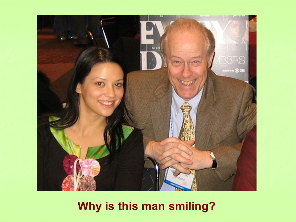 Why is this man smiling?