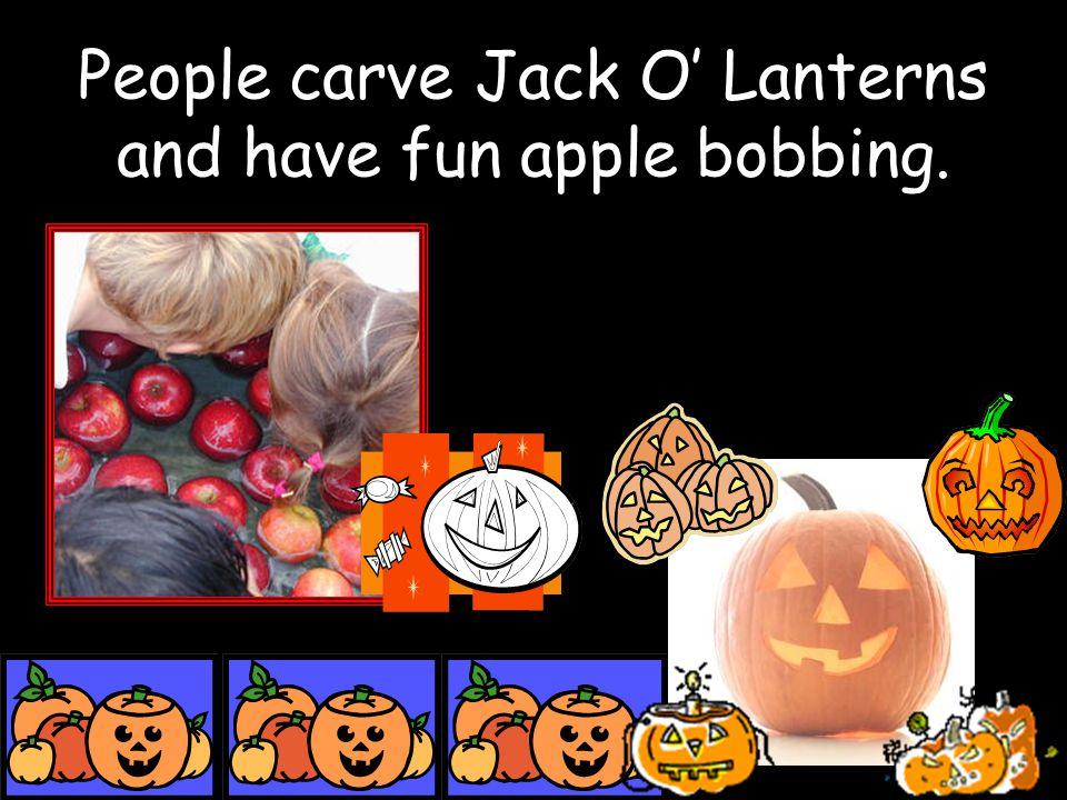 People carve Jack O' Lanterns and have fun apple bobbing.