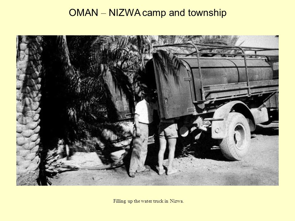 Filling up the water truck in Nizwa. OMAN – NIZWA camp and township
