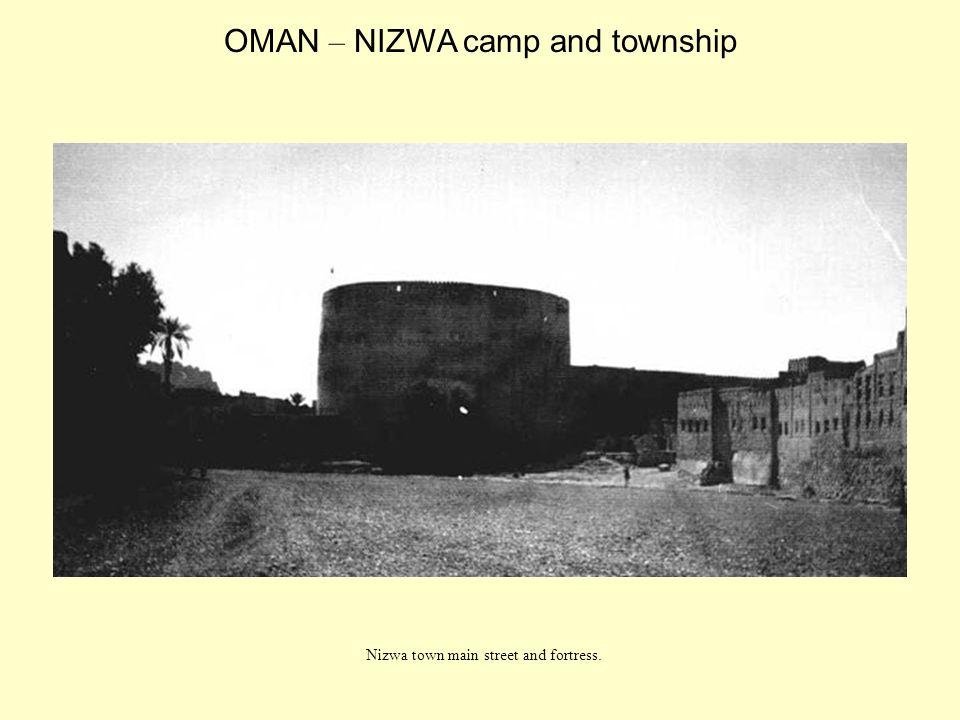 Nizwa town main street and fortress. OMAN – NIZWA camp and township