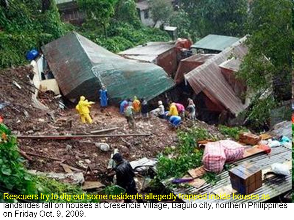 Houses are submerged in flash floods caused by rains from tropical storm Parma in Baguio City October 9, 2009.
