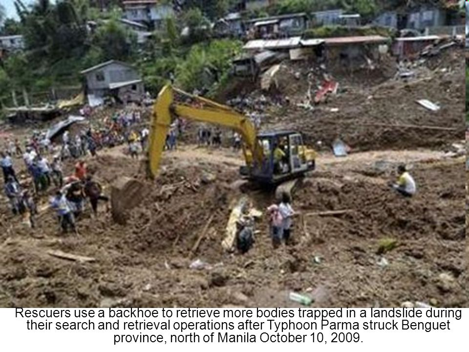 Rescuers and volunteers search for possible survivors after they were buried alive when a mountain slide hit several houses at the height of Typhoon Parma that hit La Trinidad, Benguet, north of Manila, October 9, 2009.