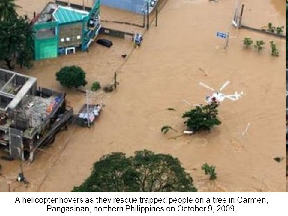 A PCG helicopter goes around flooded villages in Carmen, Pangasinan province, northern Philippines on Friday, Oct. 9, 2009.